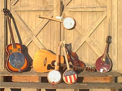[Photo of LicketySplit Banjo with Other Instruments]